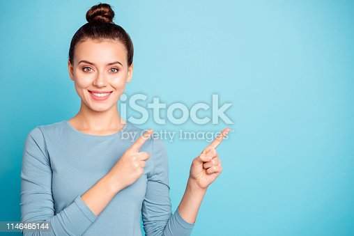 Close up photo beautiful amazing she her lady arms hands fingers indicate empty space proposition advising buy buyer best low little price wear casual sweater pullover isolated blue bright background.