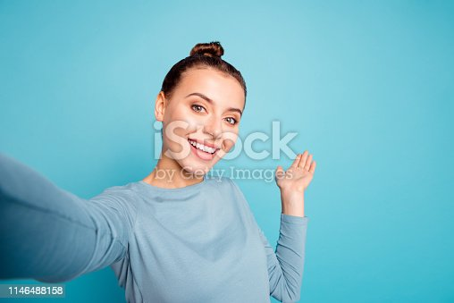 Close up photo beautiful amazing she her lady make take selfies show hand arm palm air showing way road foreigners broadcasting blog wear casual sweater pullover isolated blue bright background.