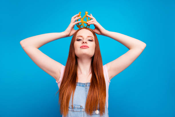 close up photo beautiful amazing she her lady self coronation process headwear head glossy yellow gold crown presenting special status wear casual jeans denim overalls clothes isolated blue background - arrogance stock pictures, royalty-free photos & images