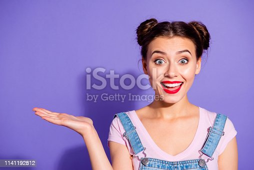 933380808 istock photo Close up photo beautiful amazing she her lady two hair buns show new product proposing low prices buy buyer wear casual t-shirt jeans denim overalls clothes isolated purple violet background 1141192812