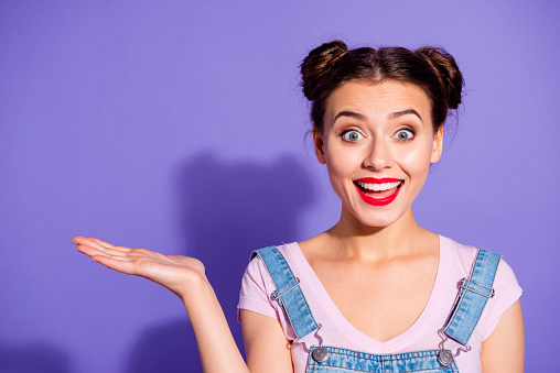 istock Close up photo beautiful amazing she her lady two hair buns show new product proposing low prices buy buyer wear casual t-shirt jeans denim overalls clothes isolated purple violet background 1141192812