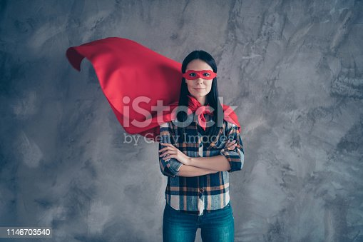 Close up photo beautiful fearless she her superpower lady comics costume heroine women equal rights concept strong hands arms wear red eye mask flight mantle home room loft apartment flat indoors.