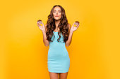 istock Close up photo beautiful her she lady hold hands arms muffins eyes closed dreamer try not eating sugary products no sweets wear blue teal green everyday short dress clothes isolated yellow background 1137020420