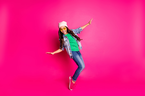 Close up photo beautiful little age she her curly lady cool arms hands, action motion disco party amazing look long hairdo wear yellow specs casual jeans denim jacket isolated pink bright background