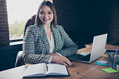Close up photo beautiful she her business lady chief use user modern technologies friendly invite candidate enter office room notebook table sit big office chair wear formal wear checkered plaid suit.