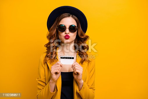 Close up photo beautiful she her coquette lady hands arms credit card abroad vacation traveler send kiss buyer present gift sale discount wear specs formal-wear isolated yellow bright background.