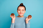 istock Close up photo beautiful she her lady advising buy buyer try new yummy just baked tasty cacao color muffins dreamy close eyes nice smell wear casual sweater pullover isolated blue bright background 1146488121