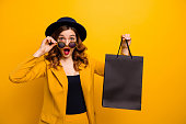 istock Close up photo beautiful she her lady black friday hold carry packs perfect look buy buyer present gift birthday low prices wear specs formal-wear costume suit isolated yellow bright background 1152389446