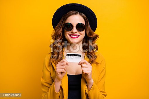 469211680 istock photo Close up photo beautiful she her lady hold hands arms credit plastic card abroad vacation traveler red lips buyer present gift  sale discount wear specs formal-wear isolated yellow bright background 1152389920