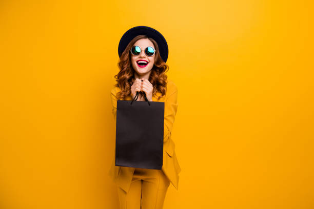 close up photo beautiful she her lady very glad black friday laughter carry packs perfect look buy buyer birthday sale discount wear specs formal-wear costume suit isolated yellow bright background - black friday imagens e fotografias de stock