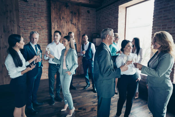Close up photo business people different age race free leisure excited team building members gathering she her he him his golden beverage toasting best brigade friendship formal wear jackets shirts stock photo
