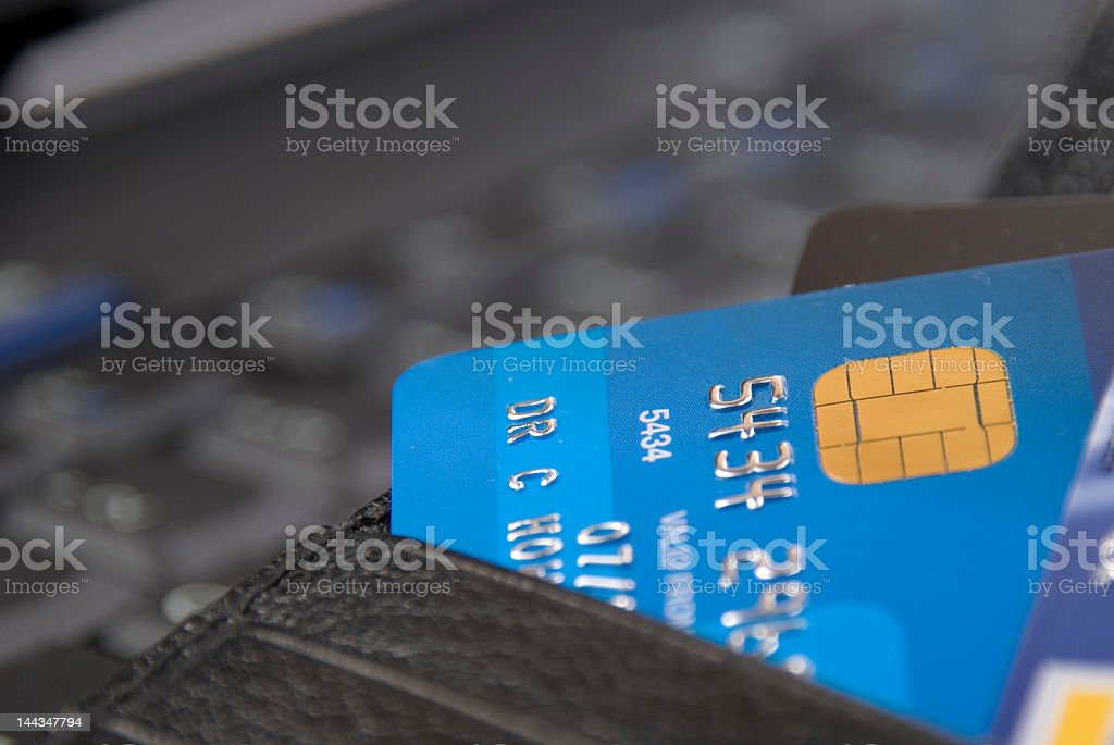 Close up photo of a blue credit card emerging from a wallet - Royalty-free Computer Chip Stock Photo