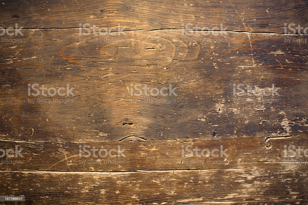 Close up photo of a distressed wood table stock photo