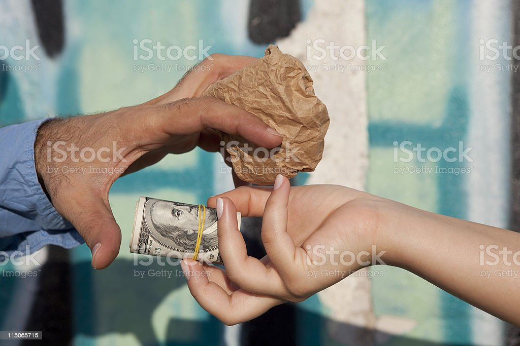 Close Up Photo Of A Man And Woman Trading Drugs stock photo