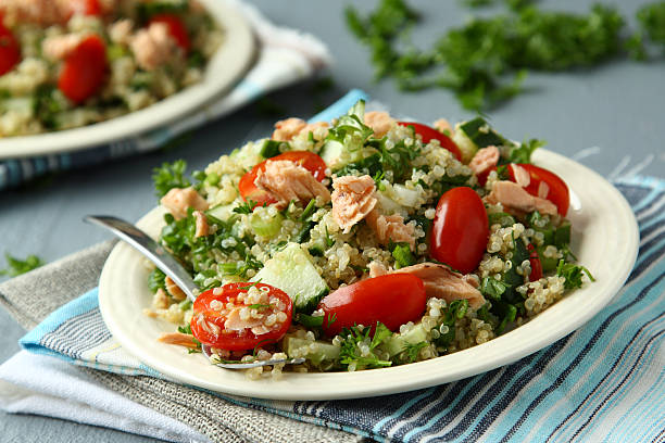 Close up photo of a tabbouleh salad with quinoa and salmon stock photo