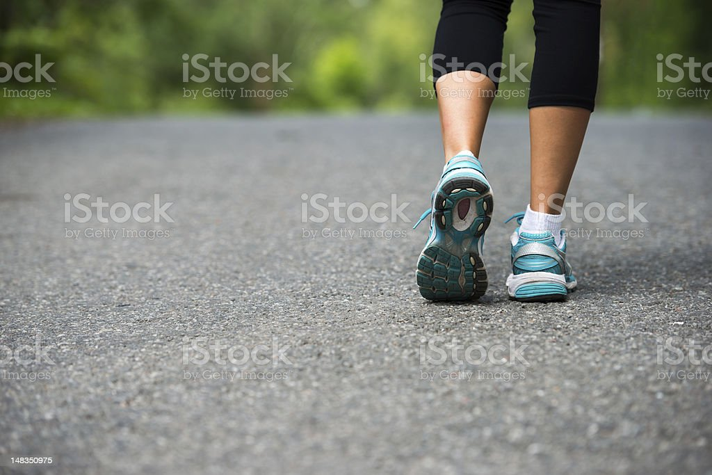 Close up photo of a woman's blue walking shoes royalty-free stock photo