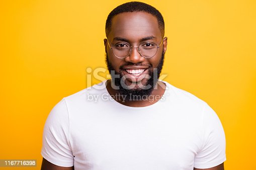 1163696387 istock photo Close up photo of afro american man staring at camera while isolated with bright yellow background 1167716398