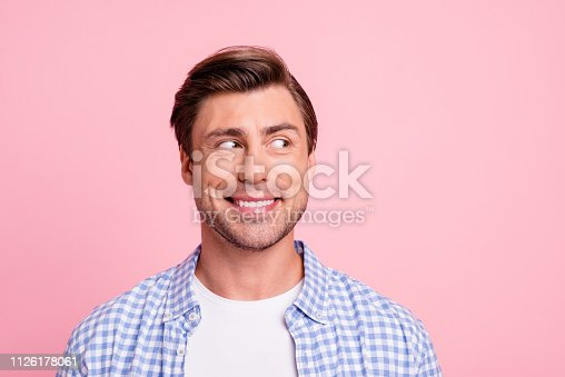 istock Close up photo of amazing he him his man looking with wonder to empty space decided to make not good thing wearing casual plaid shirt outfit isolated on pale rose background 1126178061