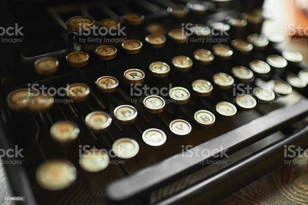 Close up photo of antique typewriter keys, shallow focus stock photo