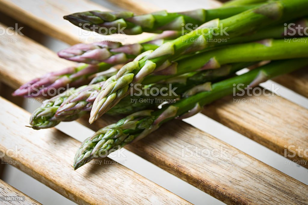 Close up photo of asparagus spears on a wooden table  stock photo