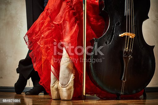 Close up photo of ballet pointe and latin dancers shoes and cello