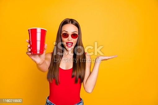 Close up photo of beautiful lady bright lips hold hand alcohol beverage shocked, good taste wear sun specs red body tank-top denim shorts