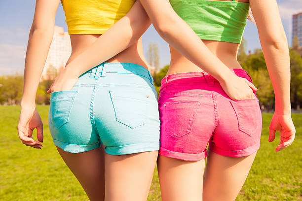 close up photo of beautiful shapely woman in shorts - buttock stock photos and pictures