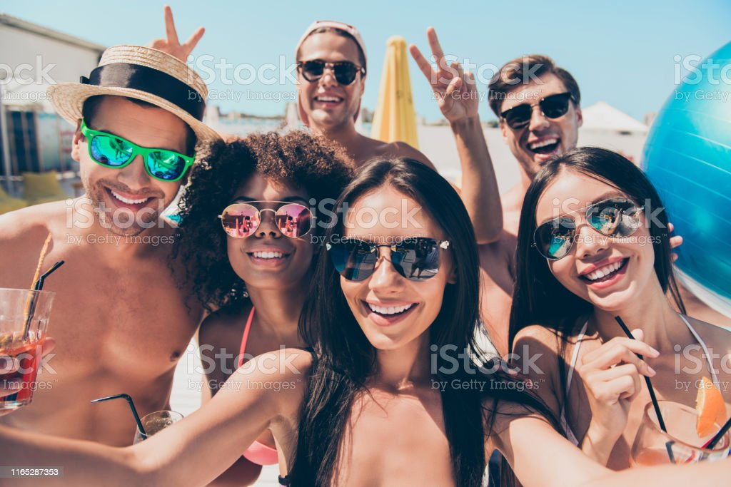 Close up photo of charming brunette students, photographers making...