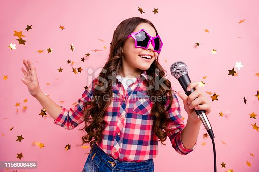 Close up photo of cool attractive crazy lady kid have fun visit event future, musician loud voice solo hold hand free time stylish checked shirt isolated over pink background long haircut hairdo