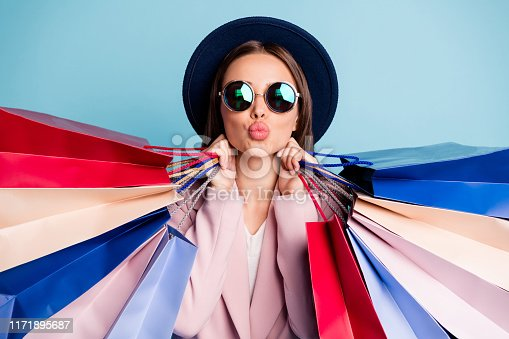 istock Close up photo of dreamy romantic lady in retro vintage cap have travel trip shop prepare for date send air kisses wear stylish topcoat isolated over blue background 1171895687