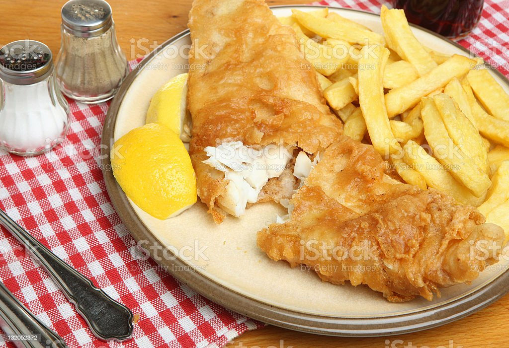 Close up photo of fried fish and chips on a plate stock photo