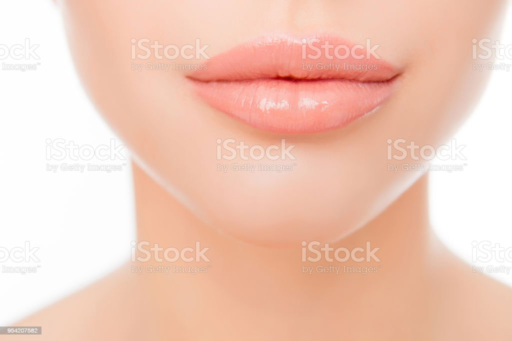 Close up photo of full woman's lips after augmentation stock photo