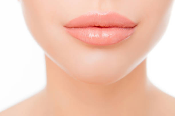 close up photo of full woman's lips after augmentation - human lips stock pictures, royalty-free photos & images