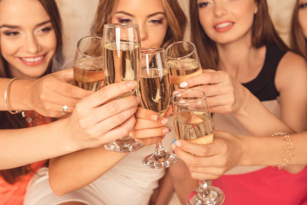 Close up photo of girls celebrating a bachelorette party and clinking Close up photo of girls celebrating a bachelorette party and clinking bachelor stock pictures, royalty-free photos & images