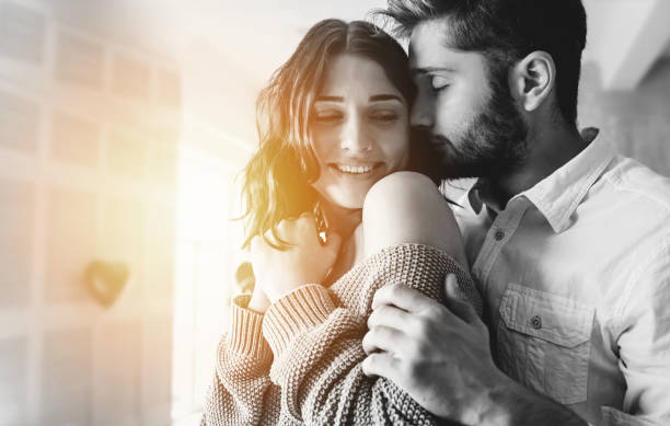 close up photo of handsome young man is kissing his beloved cute woman in date romantic day - falling in love stock pictures, royalty-free photos & images