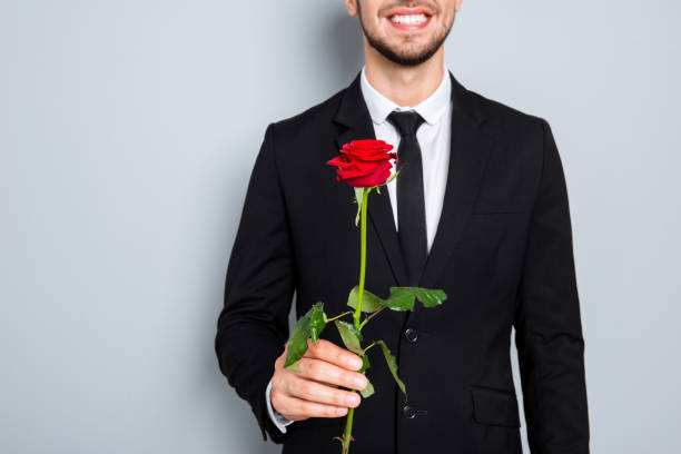 Close up photo of happy smiling businessman with red rose picture id945520308?b=1&k=6&m=945520308&s=612x612&w=0&h=kglyhxxn2kbqwvcnjnqut cv6i7wv lgvmkuiq yjru=