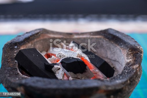 Close up photo of Ignited charcoal