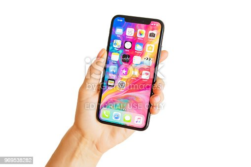 Riga, Latvia - March 15, 2018: Close up photo of latest generation iPhone X in person's hand. iPhone X is a smartphone designed, developed, and marketed by Apple Inc. It was announced on September 12, 2017.