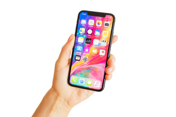 Close up photo of latest generation iPhone X in person's hand. stock photo