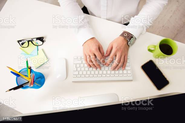 Close up photo of mans hands typing on keyboard picture id1139226377?b=1&k=6&m=1139226377&s=612x612&h=dnbyq8vslh0q75lsjnmdo1l3r45nsm6omiardseumos=