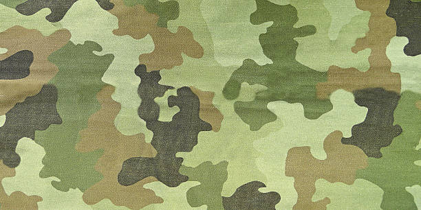 Close up photo of multicam camouflage uniform Close up photo of multicam camouflage uniform camouflage stock pictures, royalty-free photos & images