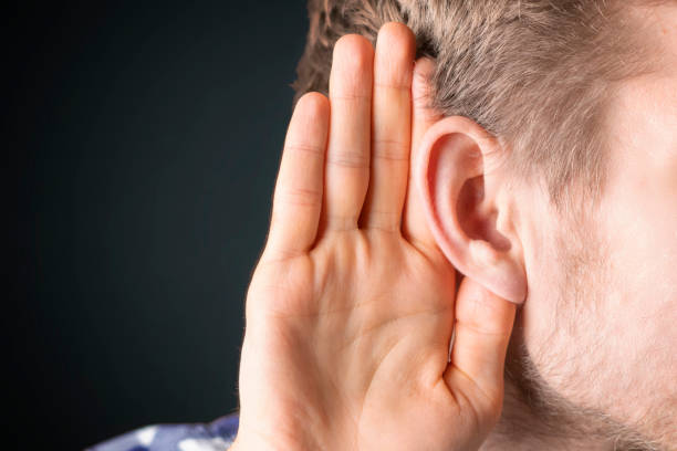 close up photo of person have ear hearing problems isolated  b stock photo