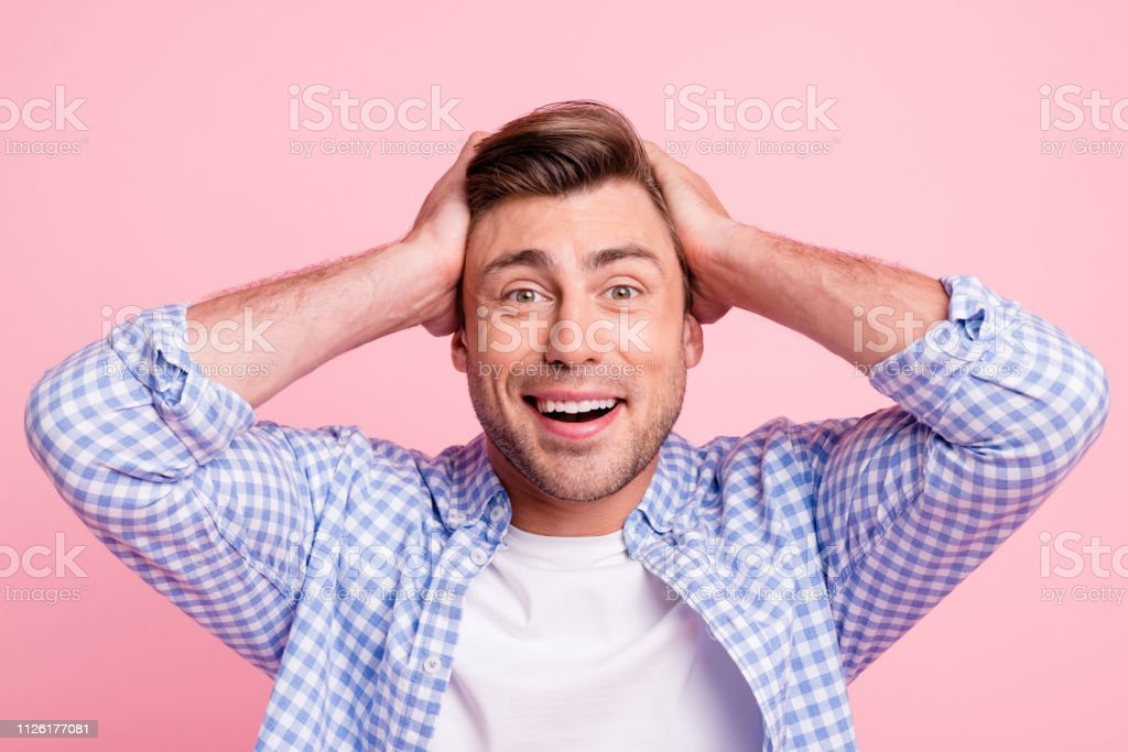 Close up photo of pretty attractive but not listening he him his man best win lucky hands in hair on head glad wearing casual shirt outfit isolated on pale rose background stock photo