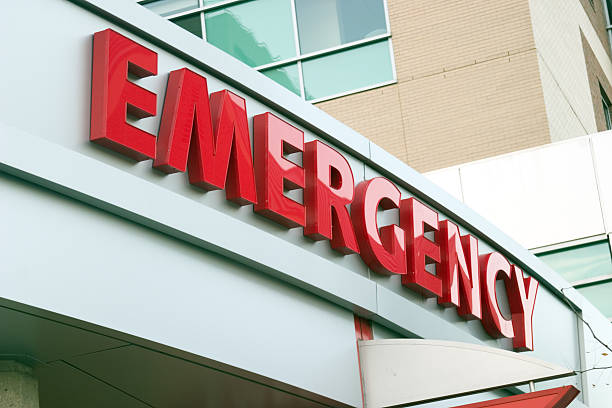 Close up photo of red large letters spelling emergency stock photo