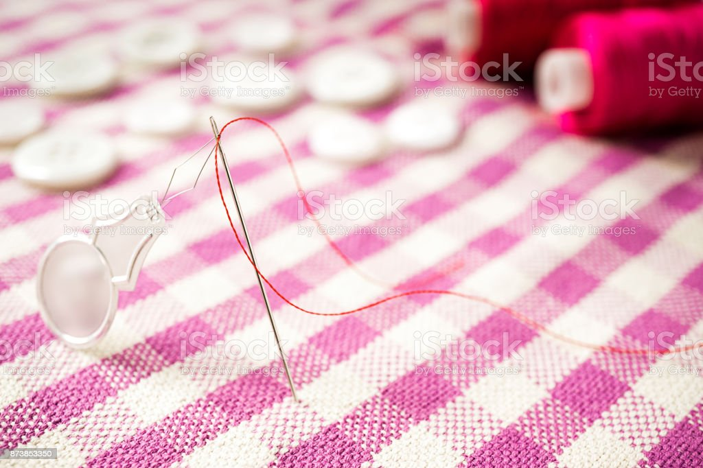 Close up photo of sewing needle stock photo