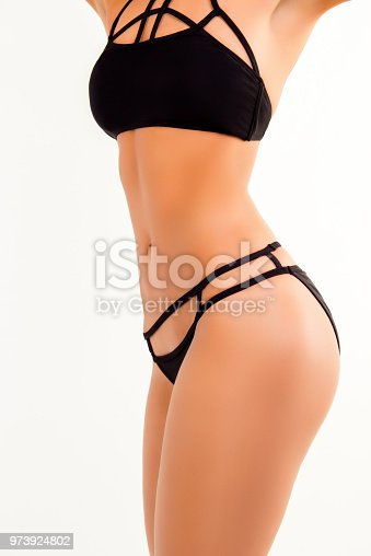 676005390istockphoto Close up photo of slim fit woman's body in black lingerie 973924802