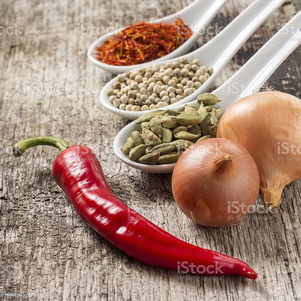Close up photo of spices with chili pepper and onion royalty-free stock photo