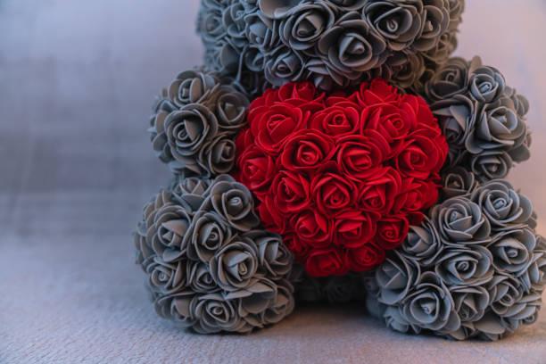 Close up photo of the grey teddy bear that sitting on sofa and red picture id1203075306?b=1&k=6&m=1203075306&s=612x612&w=0&h=z5btkbz2ll6uabavq39 mwzh2fk efbchee1c5jfcms=