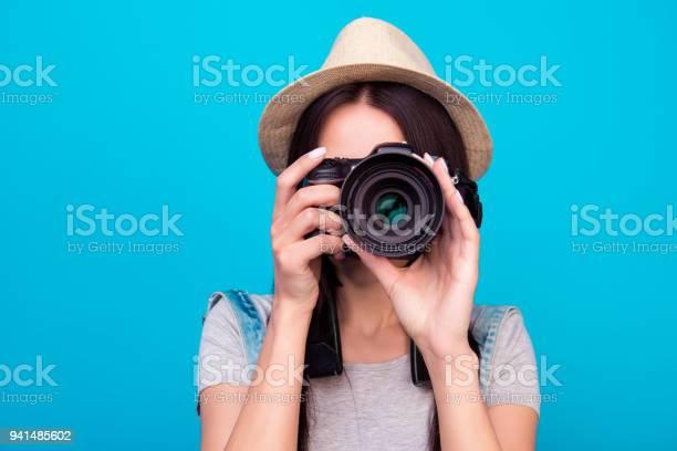 Close up photo of woman in hat on blue background taking a photo with picture id941485602?b=1&k=6&m=941485602&s=612x612&h=x94vefhha154yk1osiwisy76h5rmmfmz fmsgpbwasg=