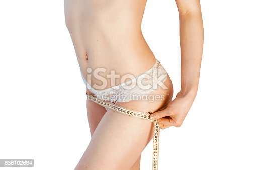 1125413862 istock photo Close up photo of woman measuring her leg's size with tape measure 838102664
